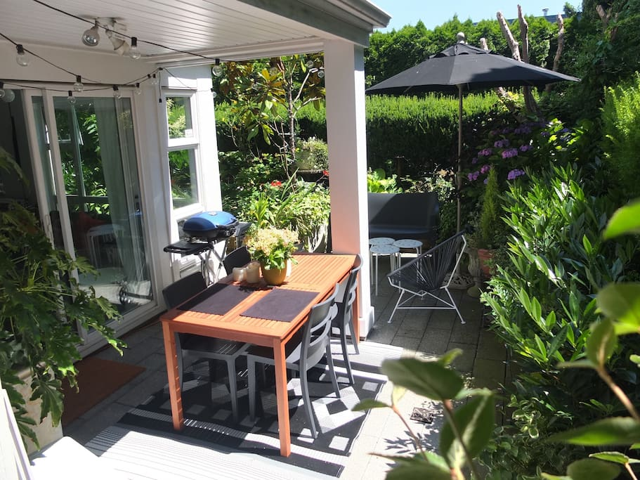 Private outdoor terrace features dining table for up to 6, sitting area for 4, BBQ and lush/private garden. There is a pathway from here that connects to a large, open shared grassy area.