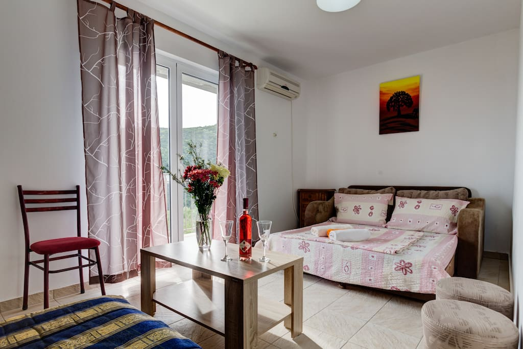Our apartment is suitable for 4 guests. Living room, beside being a way to reach balcony, can be used for sleeping purposes.