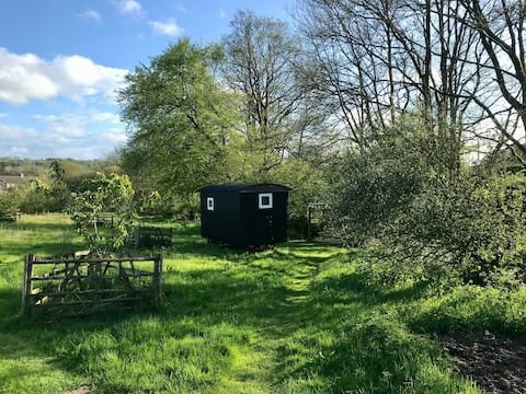 Traditional Shepherds Hut in a meadow.