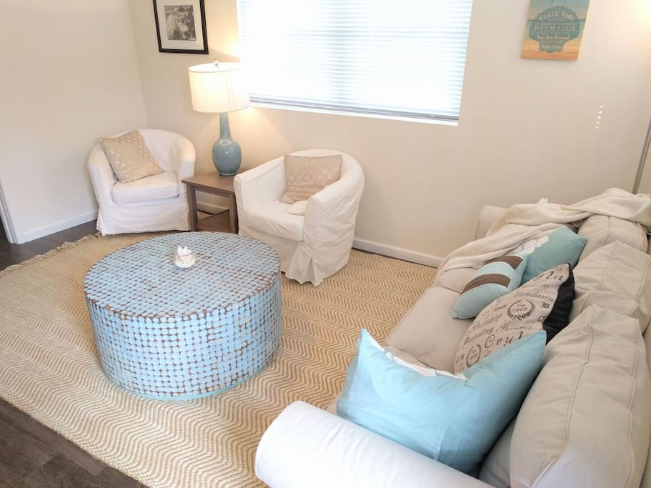 Living room has comfortable seating for six, lots of pillows and throw blankets.