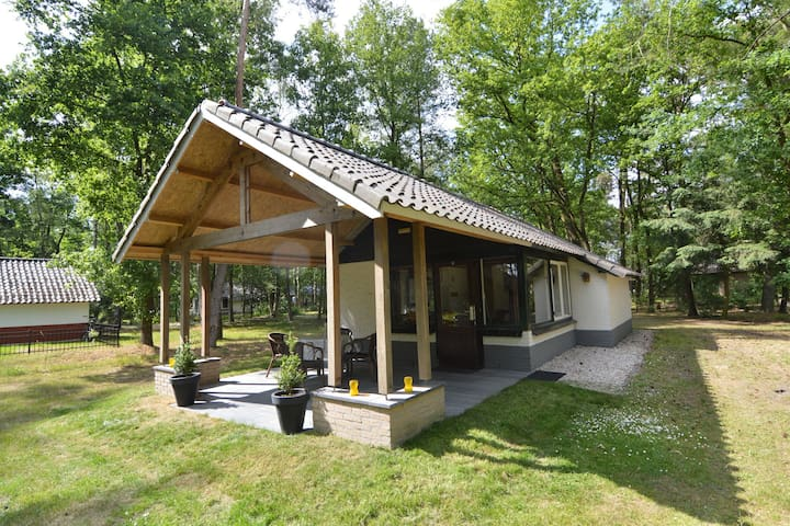 Detached bungalow with lovely covered terrace in a nature rich holiday park