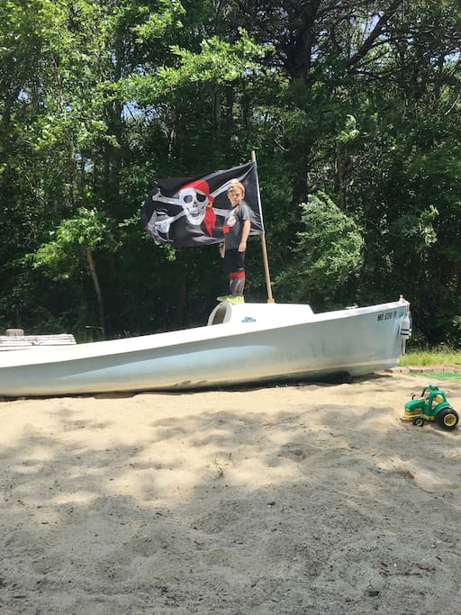 Our large sandbox for the kids has an old sailboat - perfect for playing pirates.