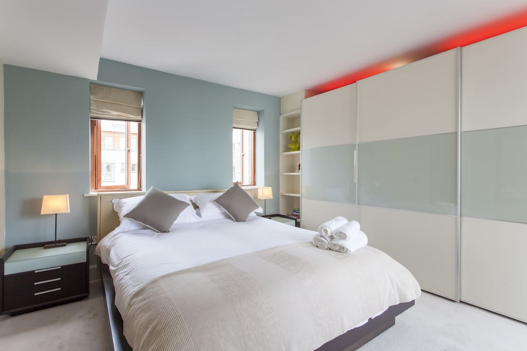 Main bedroom with new very comfy bed  as well as  hotel quality linens. Snuggle up with an  incredible view of Christchurch cathedral