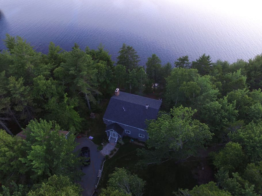 Loon Sound Lake House nestled in the pine trees on the shore of Toddy Pond.