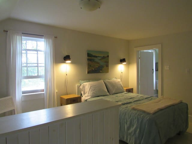 Loft bedroom with double bed and lots of closet space.