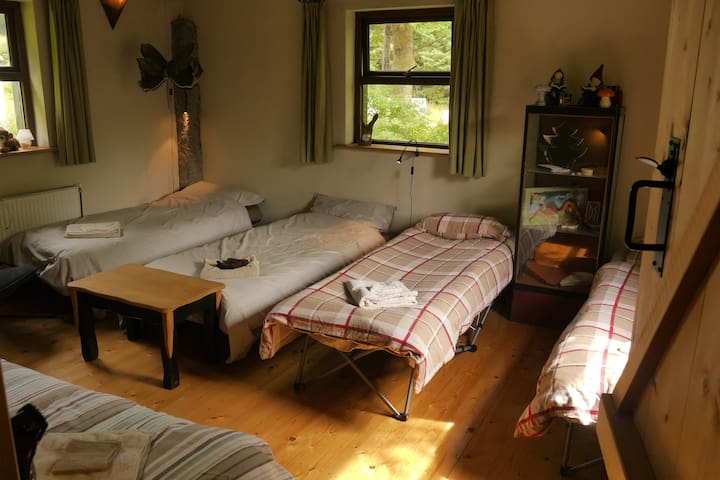 Bed in Barn for groups: up to 5 (single) Beds/military folding beds in the living room, a double bed in the master bedroom