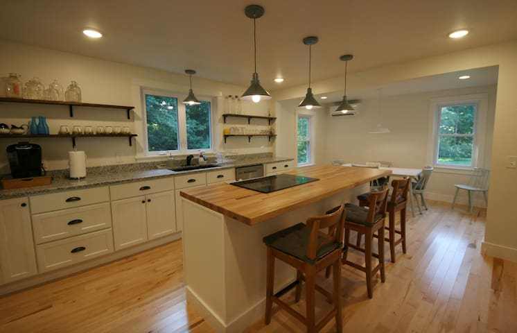 Brand new modern farmhouse kitchen w/ 8-foot island and all amenities!