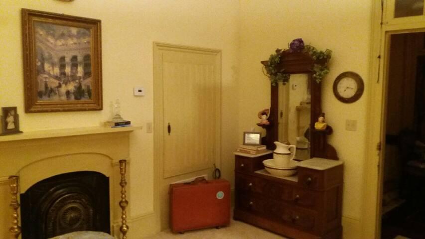 Original antique dresser still lives in suite.