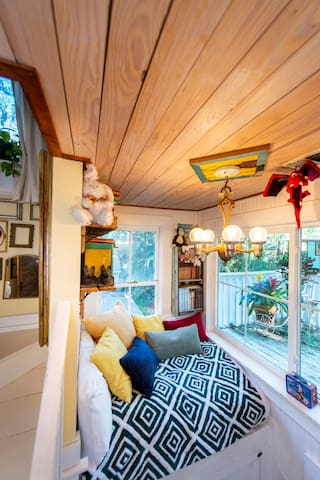 Open the window and crawl out onto the deck to make your way to the treehouse!