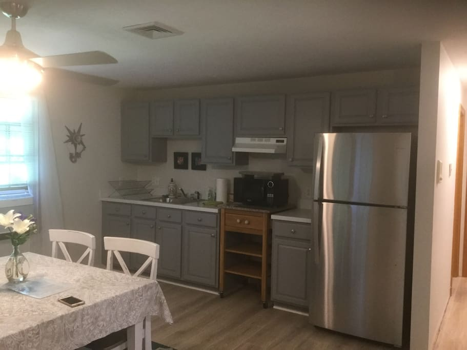 Kitchen/dining/work area. Full size refrigerator, coffee maker, and microwave. No stove.