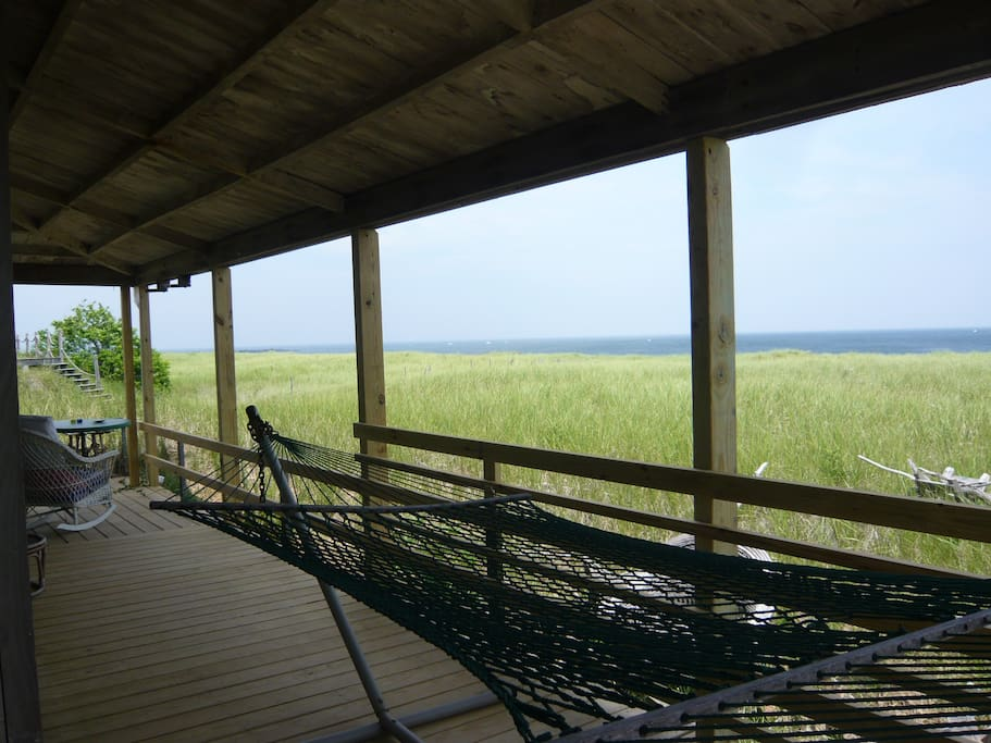 The Front Porch. The main and most popular section of the wraparound porch- with the perfect view of the Atlantic.