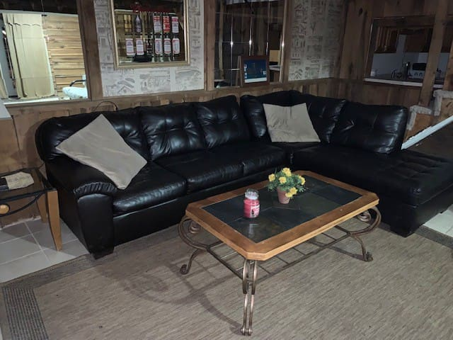 """Your private Large 24 x 24 Family room w/Fireplace and 65"""" Big Screen TV with NFL Package/HBO/Cinemax/Netflix/more. (For registered guests only) 15 foot leather Sectional couch"""