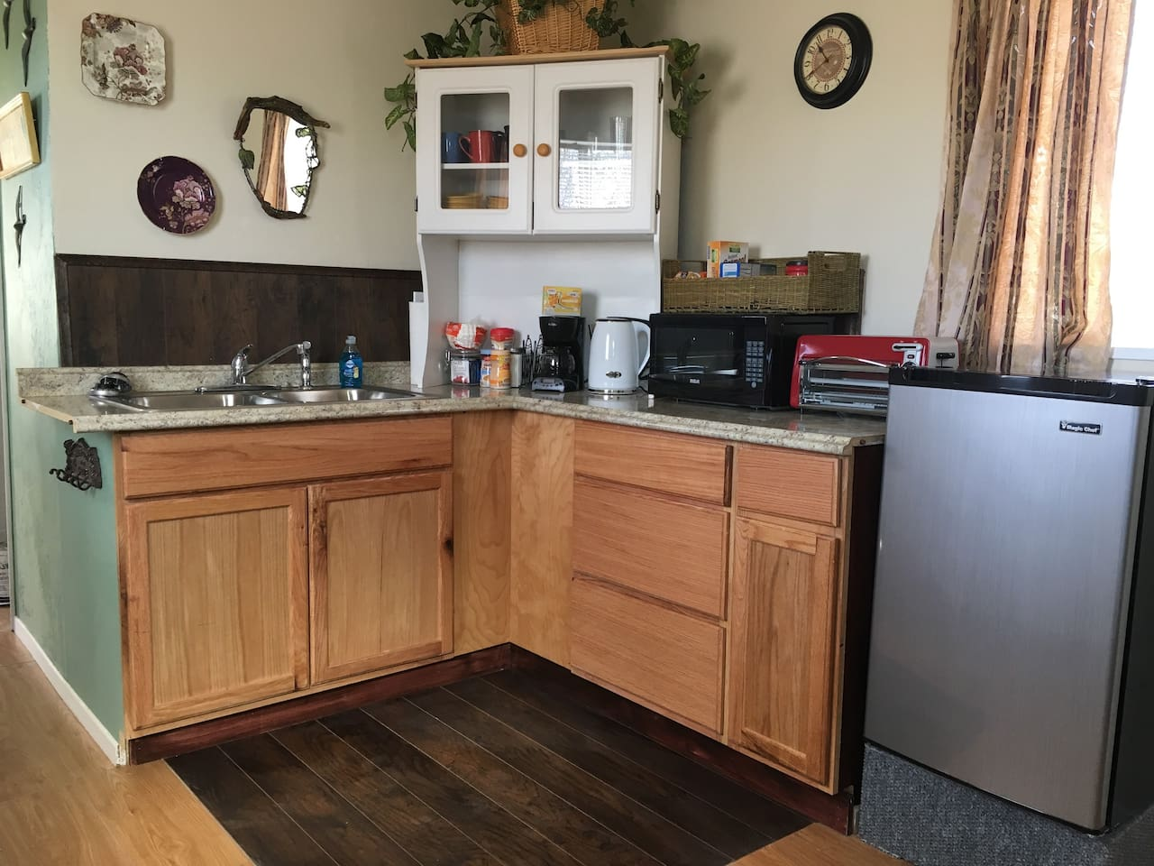 This a courtesy kitchen only with microwave, coffee pot, electric tea kettle, mini refrigerator, dishes and utensils and toaster oven.