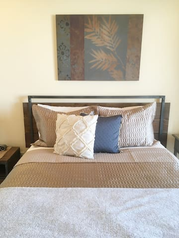 Guest Bedroom with a comfortable queen mattress