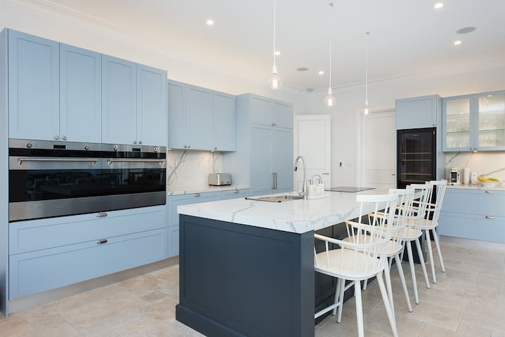 Modern Kitchen with marble tabletops