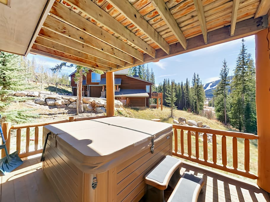 Relax in the hot tub conveniently located on the covered deck.