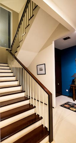 Staircase to the upstairs living and bedroom area