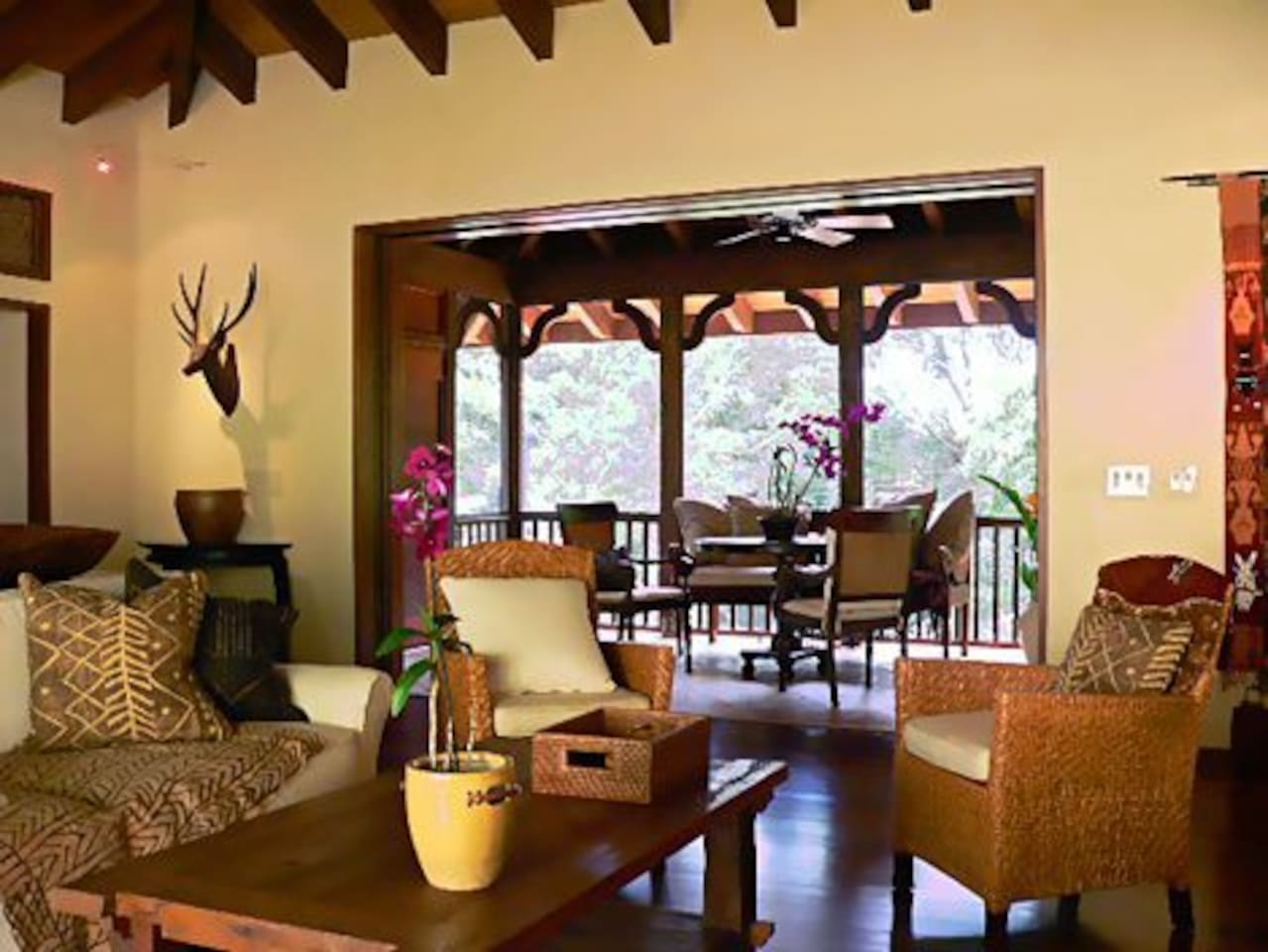 Quite and comfortable living room looking out to lanai