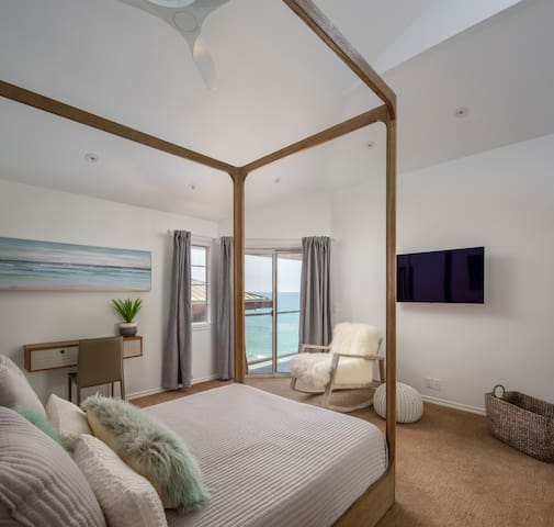 Bedroom 2 - Queen Canopy Bed, Ocean view deck, Ensuite full bathroom, 48' Smart TV, Work/ Study Desk