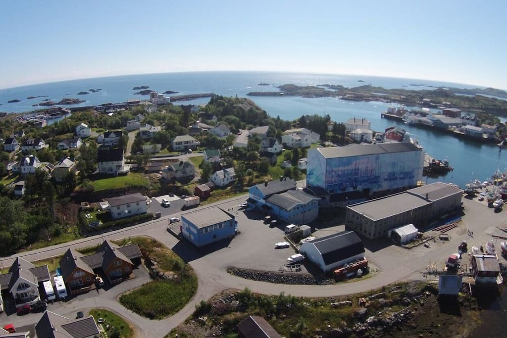 Our home is located in the heart of the fishing village Ballstad. You can see it in the lower left corner in this picture.