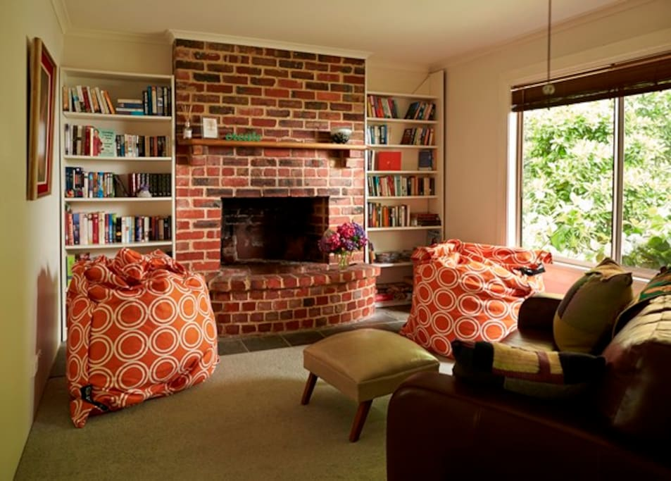 Second living area with open fireplace.