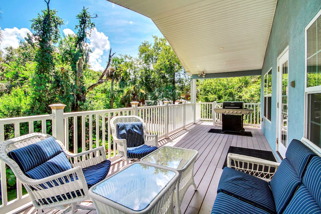 Pass the afternoon by lounging on a shaded porch with seating and a grill.