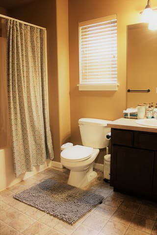 Full bath with tub. The toilet has a bidet. It's a shared bath.