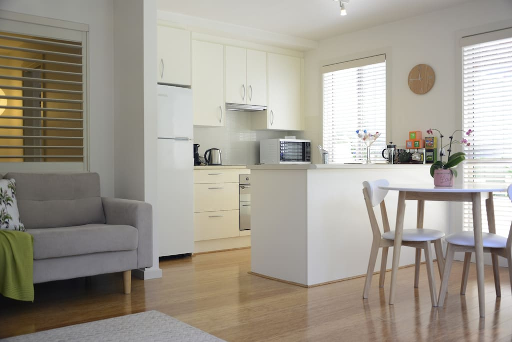 Living, dining & kitchen area. All with views to garden.