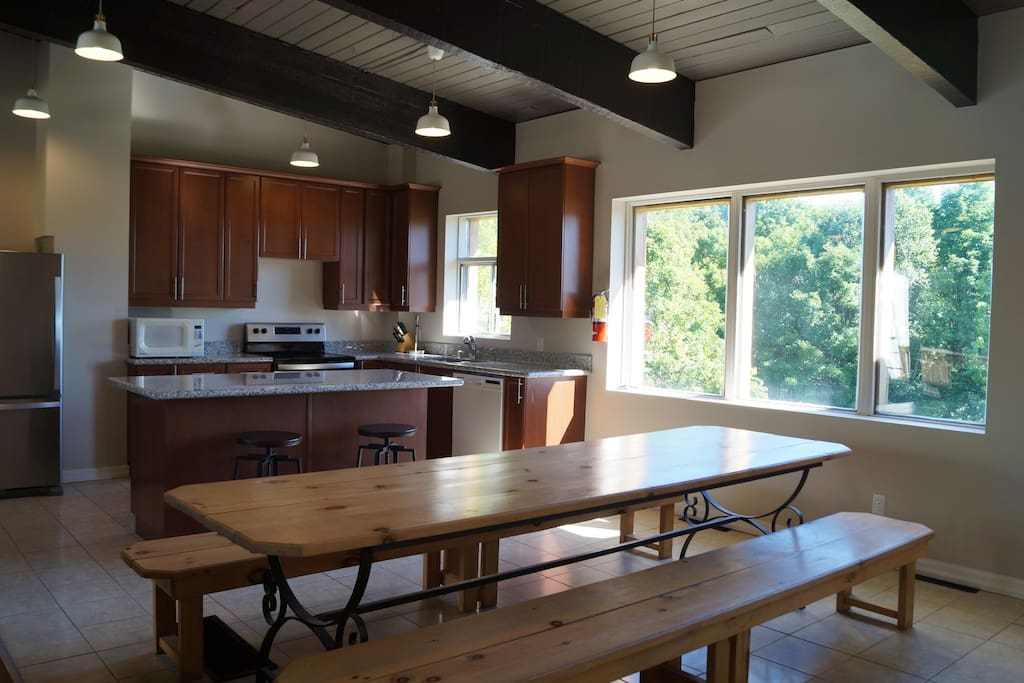 Large farmhouse table that seats 12 and extra seating at the kitchen island