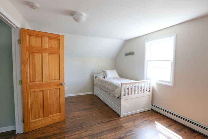 Upstairs bedroom with trundle bed. sleeps two.