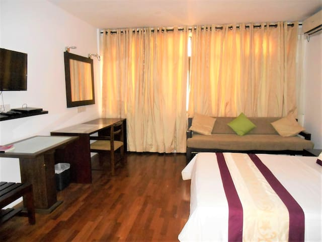 The spacious studio 2-3 in 7HCR Residencies is favored by business is equipped with a kitchen & en-suite bathroom with hot water. 7' wide sofa provides space for relaxation. wide writing & dressing tables, fast Wi-Fi & Cable TV with news & sports.
