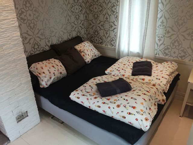 A comfortable  double bed with 160 cm wide mattress topper. The beds are attached together.