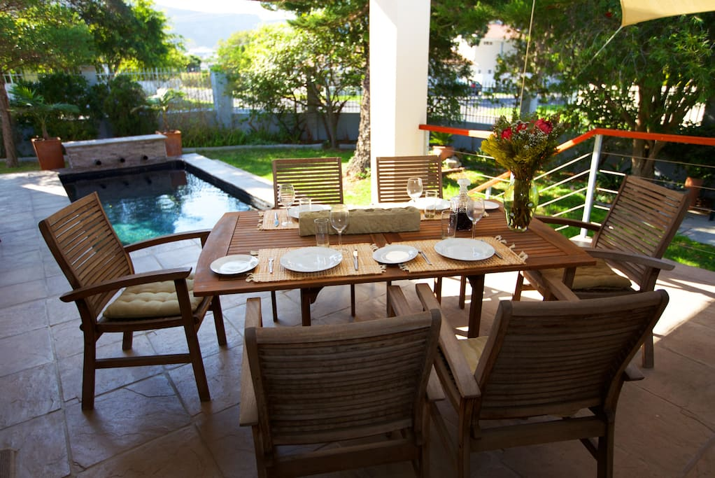 The dining area leads out to a covered braai and pool area