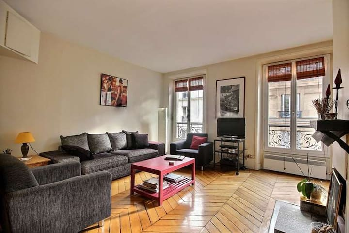 Living: The 22 square meters living room has 2 double glazed windows facing street . It is equipped with : sofa, coffee table, cable, TV, DVD, stereo, phone, 2 armchairs, built-in shelves, decorative fireplace, hard wood floor.