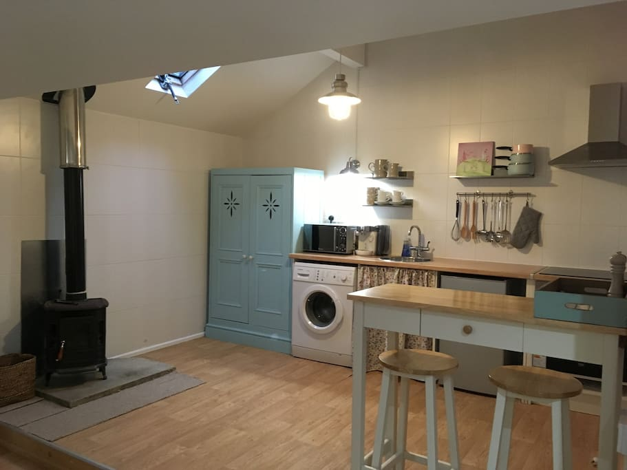 Kitchen Area with Breakfast Bar, Halogen Hob,Electric Oven, Washer & Fridge Freezer.