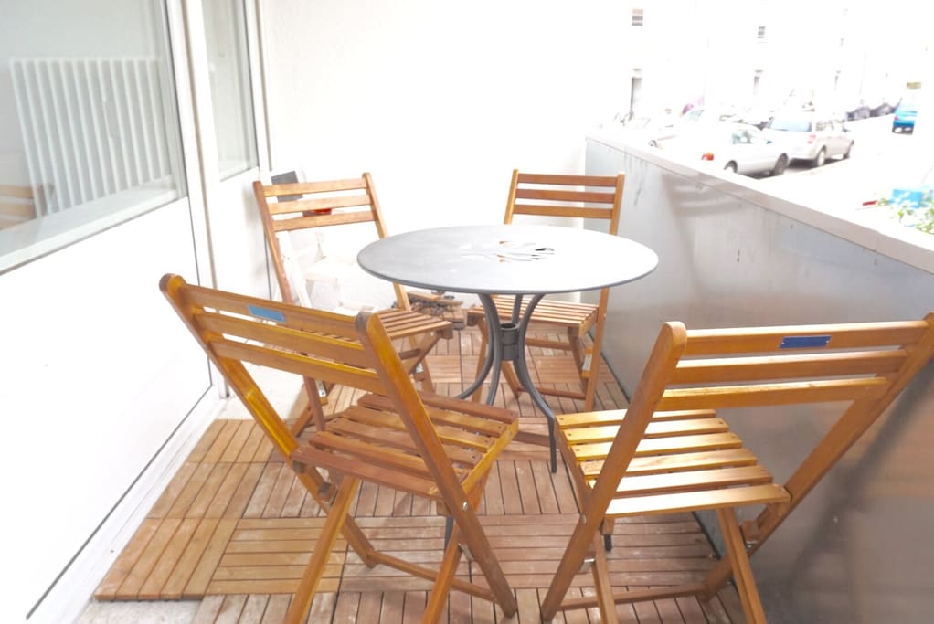The sunny balcony is the perfect place for a nice coffee.