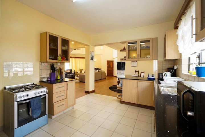 Open plan kitchen that is fully equipped with all essentials to prepare any meal