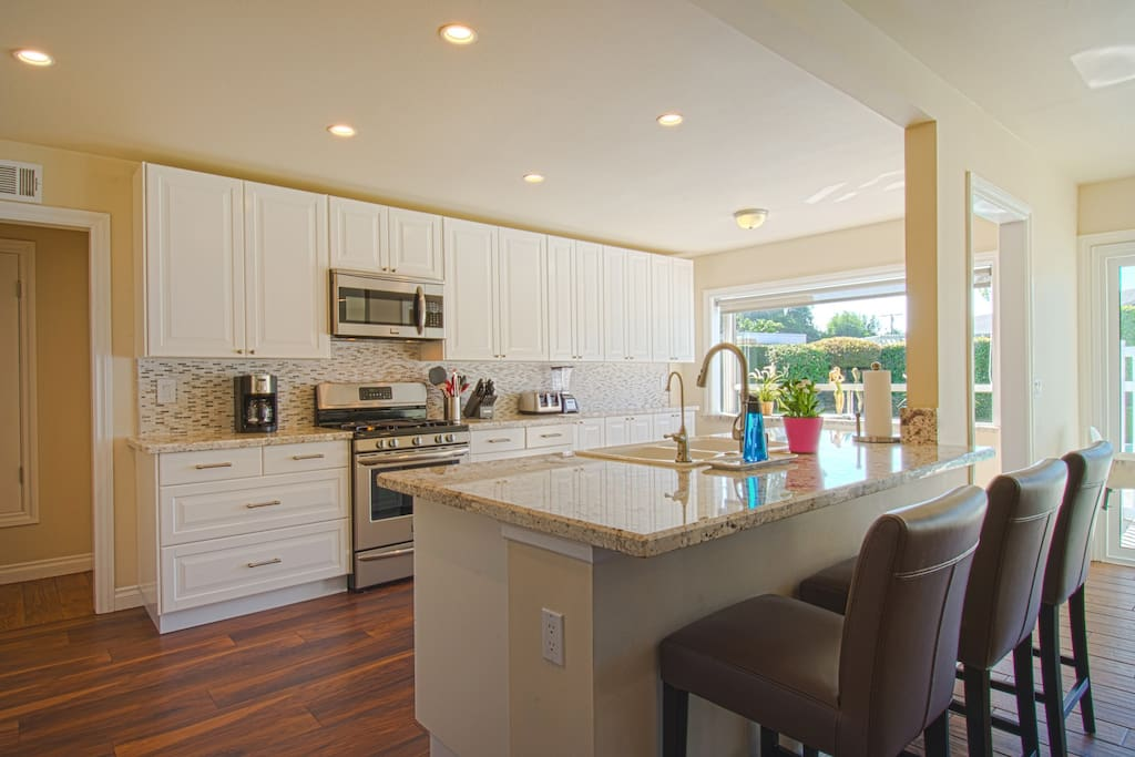 Gourmet style kitchen with bar seating, great for cooking or hanging out