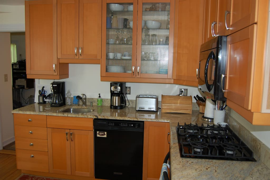 Other view of kitchen. Coffee maker, toaster, cabinet with plates etc.