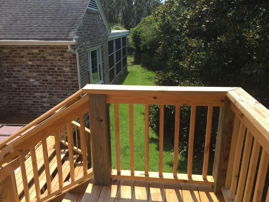 Walk through the backyard to the shared back patio with a separate entrance to the Crow's Nest