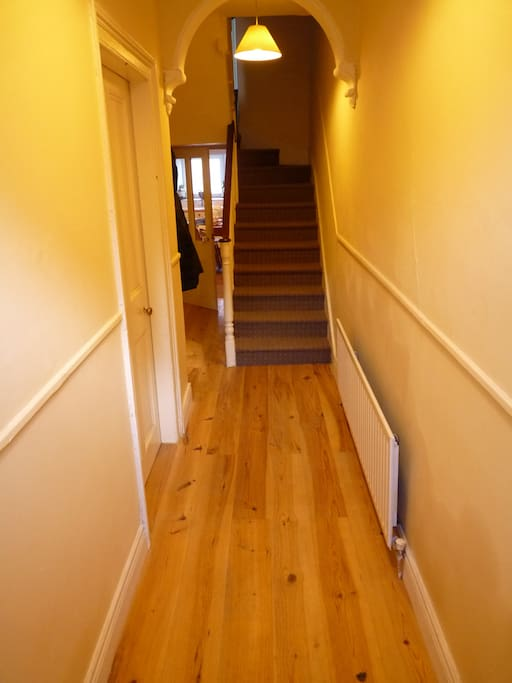 You will enter to a large hallway with original features.