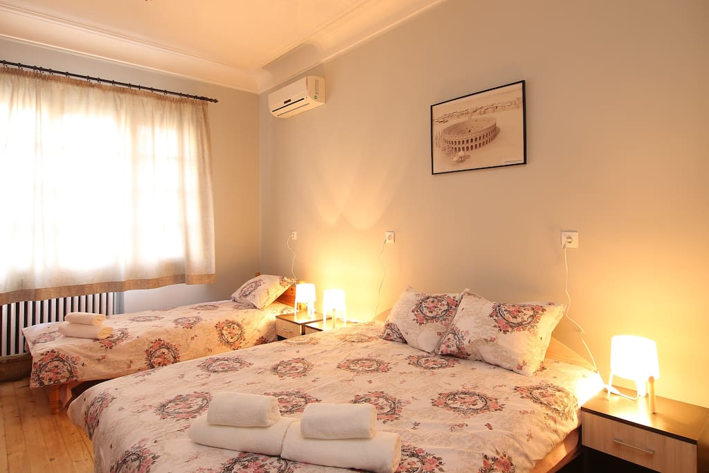 Room with double and single bed