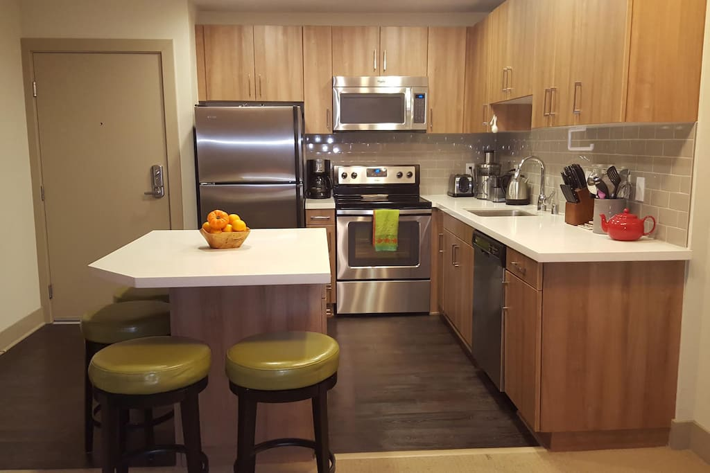 Full kitchen with Breville Juicer, Mr Coffee Coffee Maker, Electric Kettle, Toaster, all cooking needs (pots, pans, etc...), plus basic foods like oils, spices, condiments!
