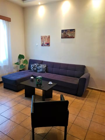 Living Room with sofa-bed, air condition,smart tv,hi-fi