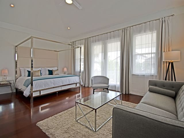 A second master bedroom has a king-sized canopy bed with its own sitting area and mini bar.