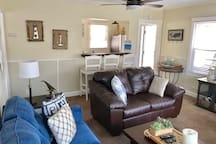 The spacious living room has plenty of comfortable seating making your stay that much more relaxing.