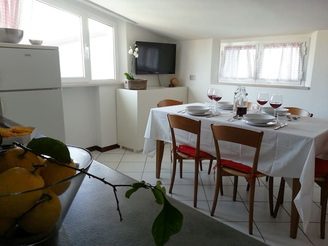 Appartamento mansardato con balcone
