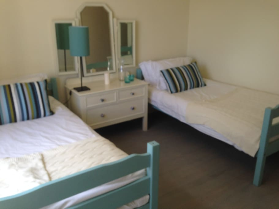 Twin bedroom overlooking swimming pool. These beds can be changed into bunks and another single bed added