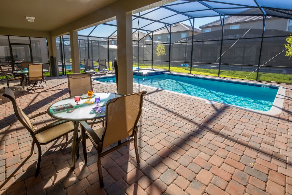 Be sure to enjoy breakfast by the pool, or an evening meal here under the lanai as you watch the Florida night skies change colors.