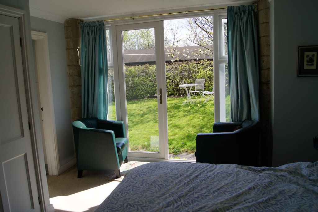 Bedroom opens directly onto the side garden.